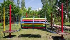 Спортивно-туристический комплекс с элементами веревочного парка, качели (гнездо) и детский троллей